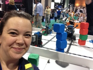 Here I am triumphant with my 4 cube tower that I built with a robot at the @vex robotics booth.
